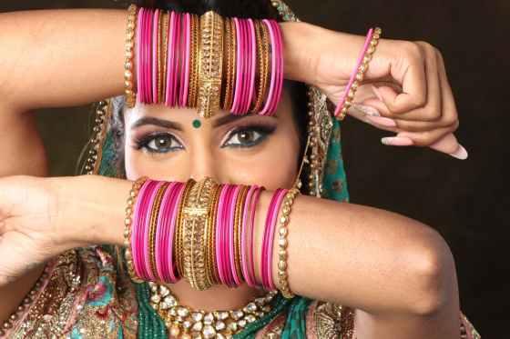 woman wearing bangle bracelets