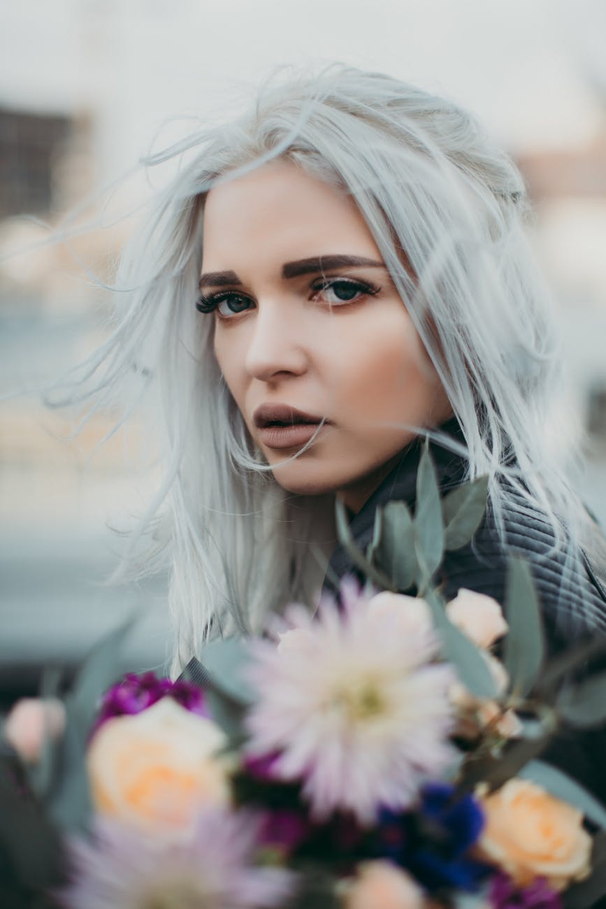 woman carrying flowers closeup photo